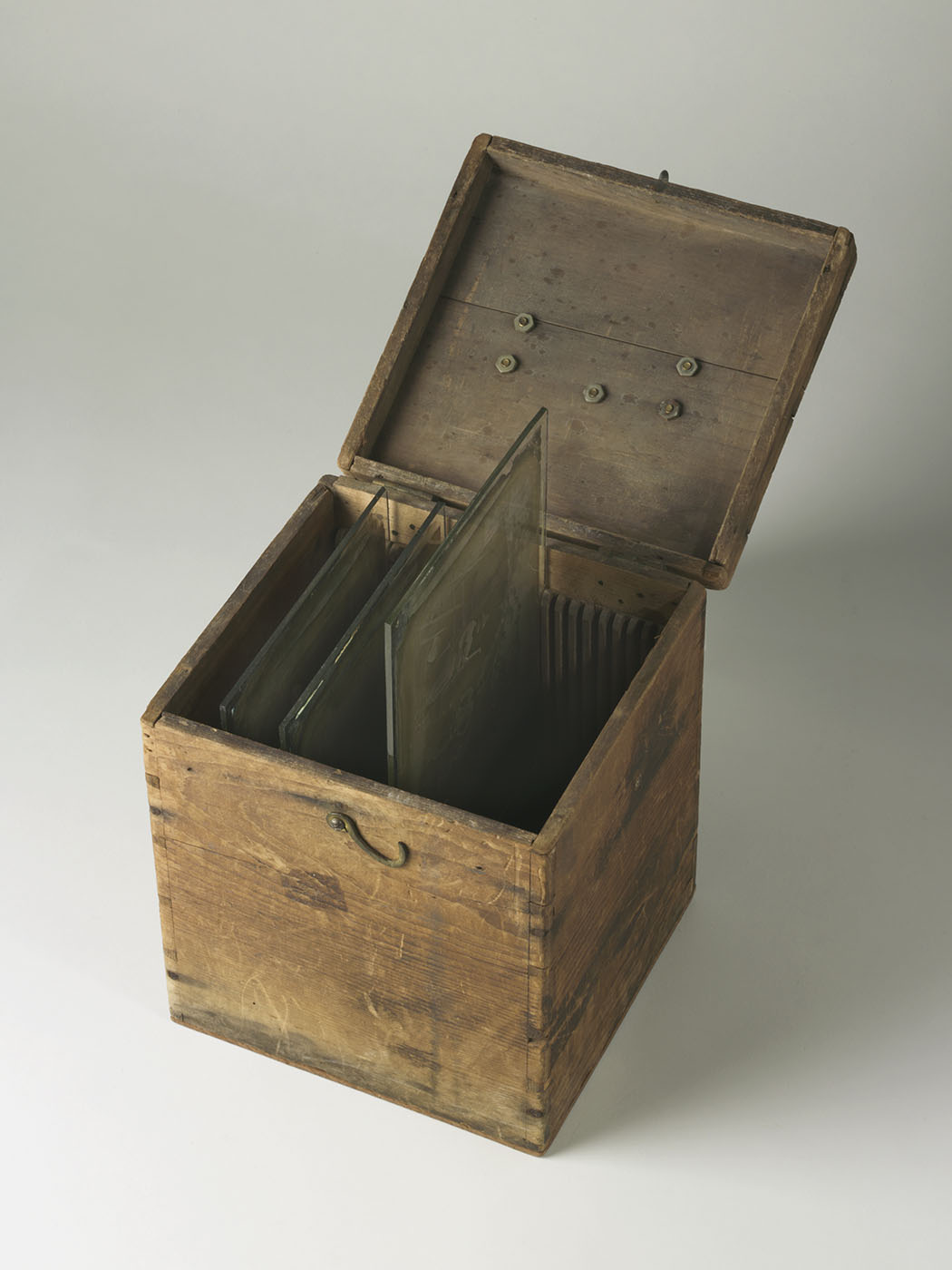 Wooden box, specially made to house glass plates, shown with its lid open. - click to view larger image