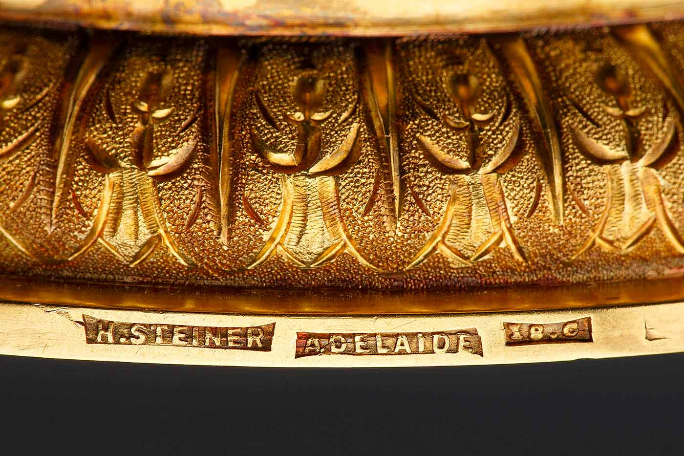 Detail of gold trophy base showing maker's mark: H Steiner / Adelaide / 18.c. - click to view larger image