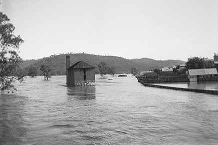 a black and white photo of an outdoor flood scene