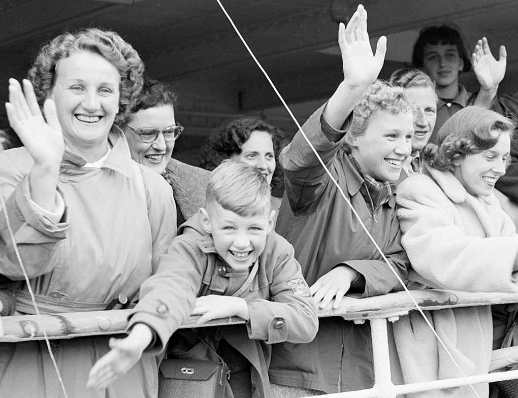 A group of new migrants aboard a ship arriving in Australia.