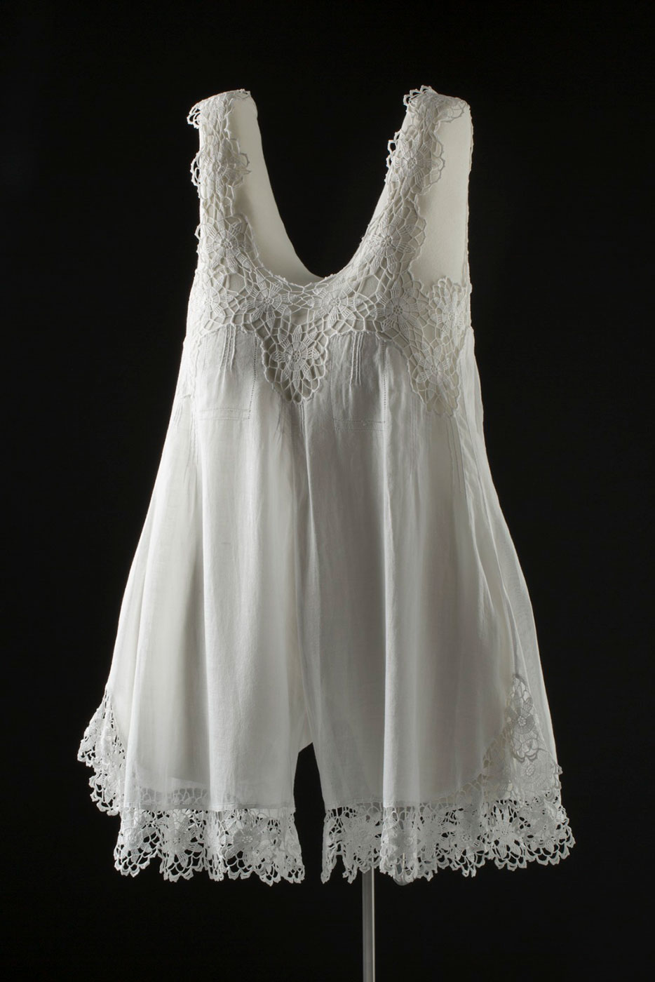 White singlet-style camisole with decorative elements around neckline and legs - click to view larger image