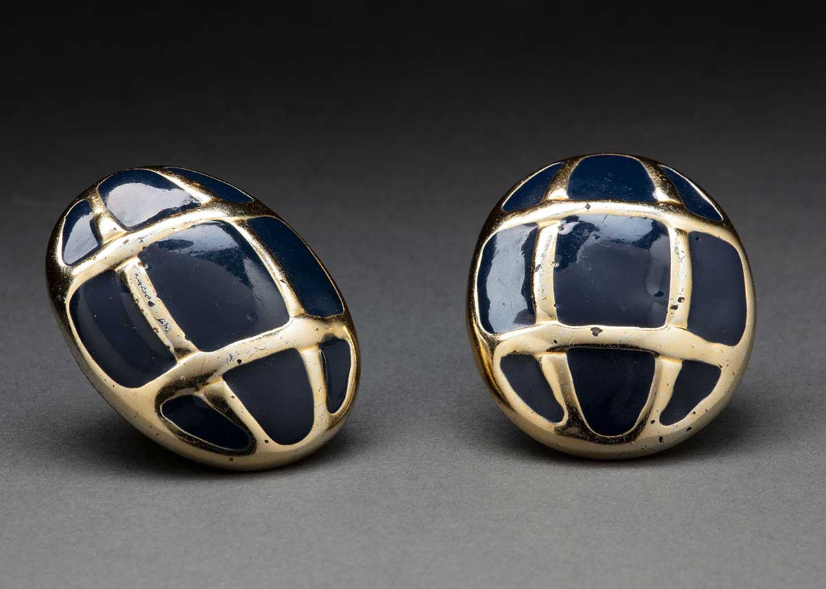 A pair of navy and gold earrings. - click to view larger image