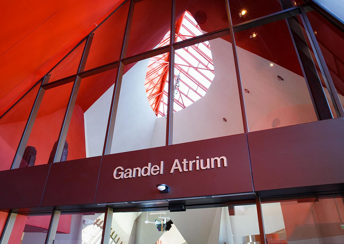 The entrance to the National Museum of Australia's building. Above the door, there's large signage in white spelling 'Gandel Atrium'.