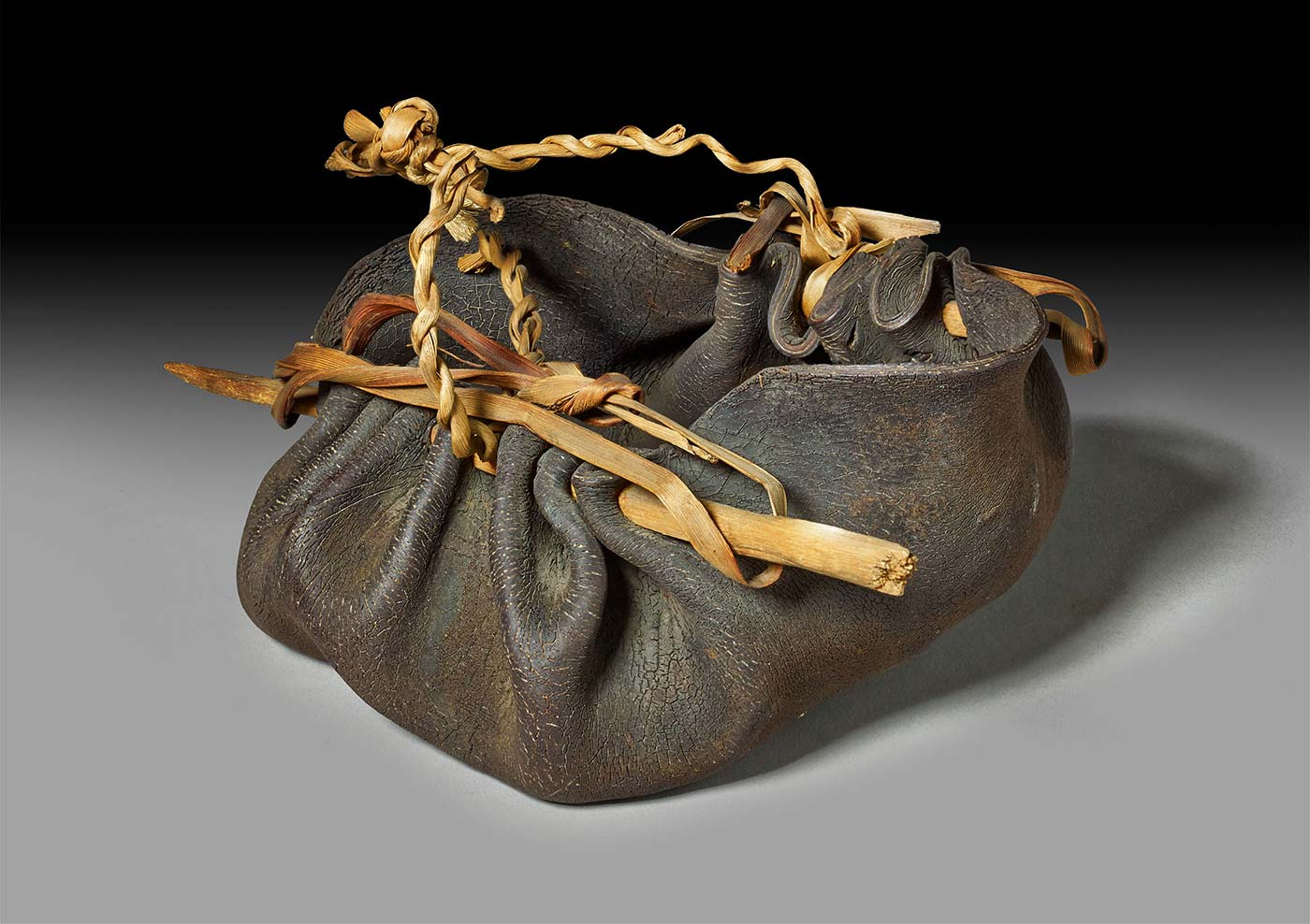 water vessel made from kelp, wood and fibre.