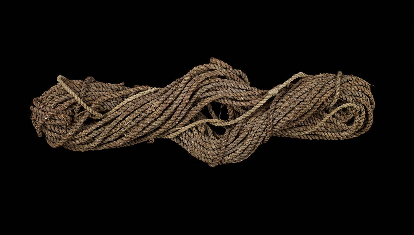 Fishing-line made of twisted brown bark fibre.