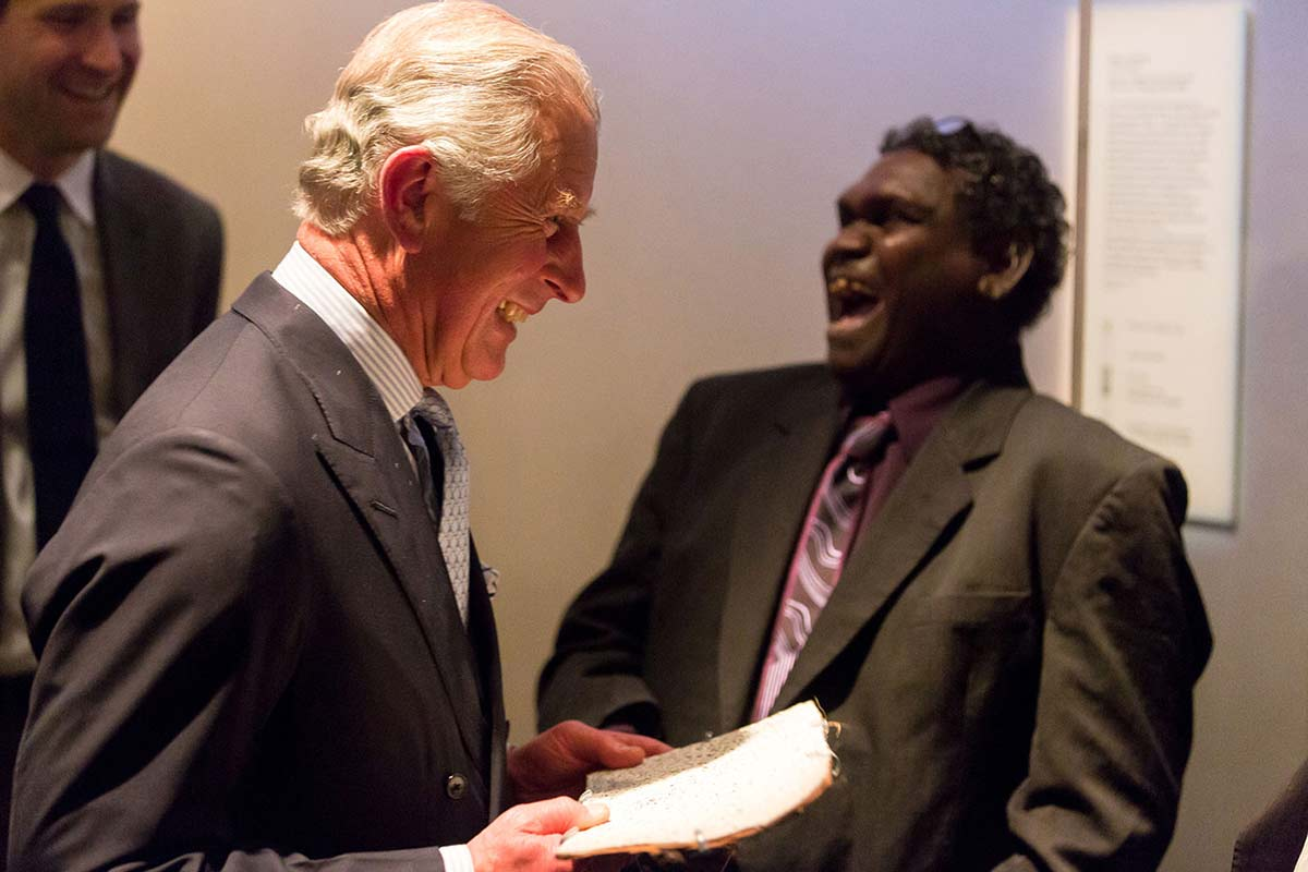 HRH Prince smiling with Aboriginal artist Wukum Wanambi laughing. - click to view larger image