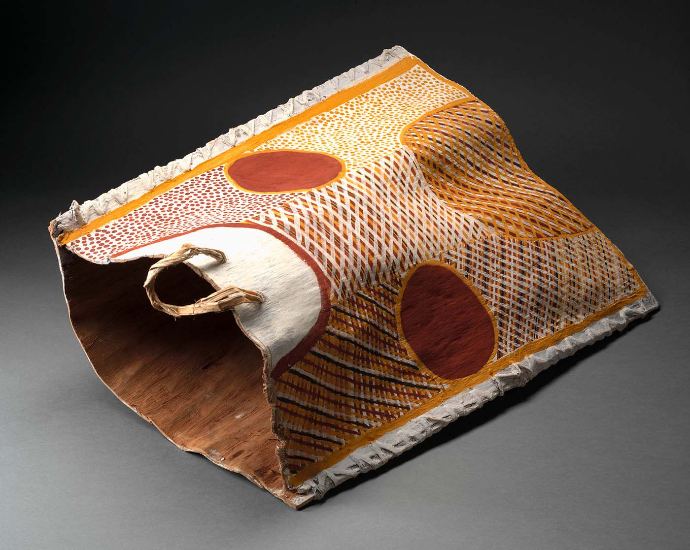 A bark container, made of eucalypt bark and natural fibre painted with natural ochres. - click to view larger image