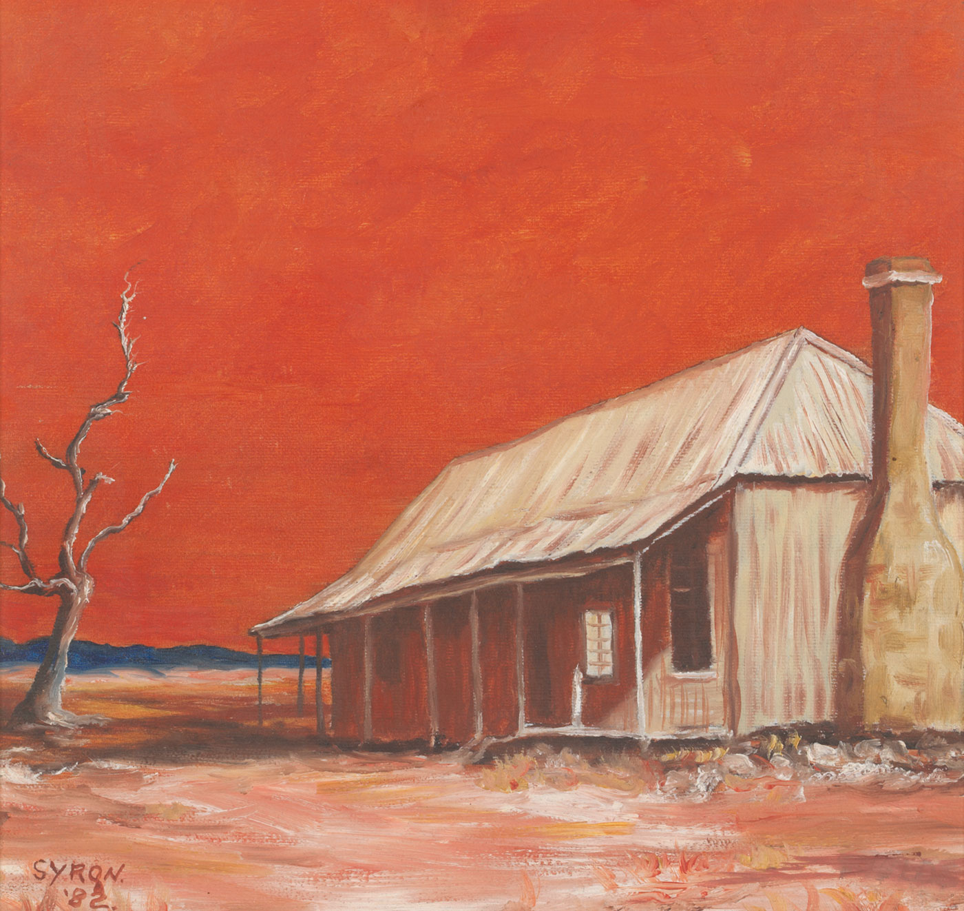 A colour painting on board featuring a dead tree and a building against a red sky. The slab-style hut, on the right, has a verandah at the front and a stone chimney at one side. In the bottom left corner of the painting is the signature 'SYRON. / '82'. The painting has a brown wooden frame with gold trim.