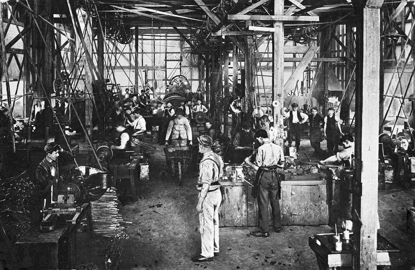 Black and white photo of men working in a factory.