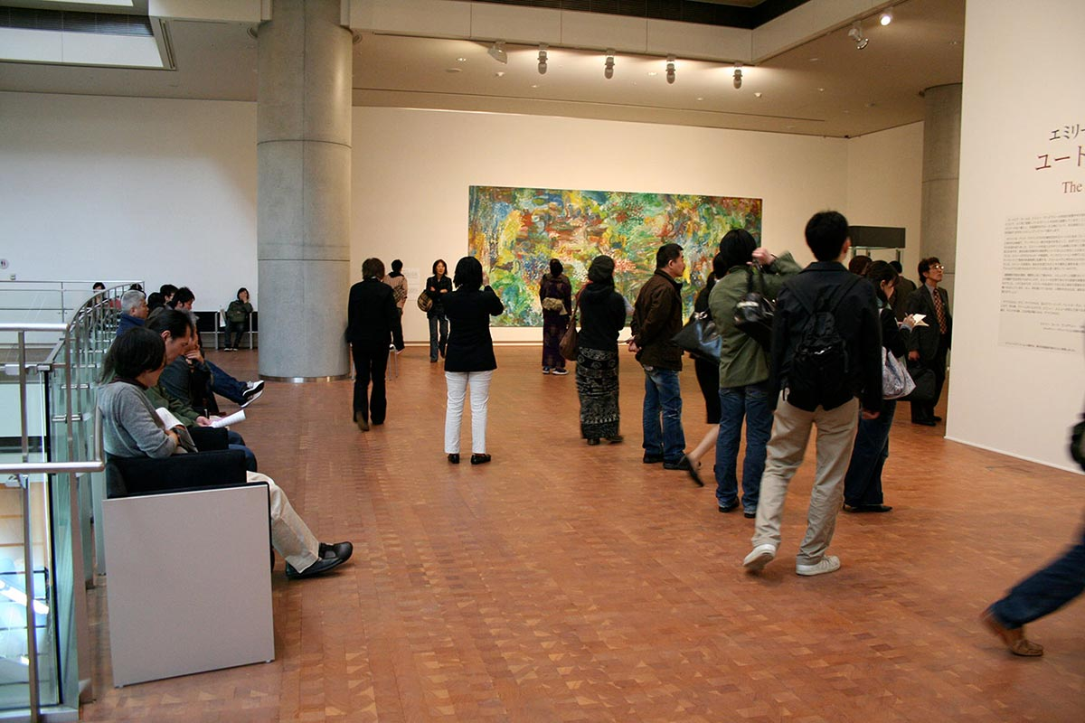 Visitors in an exhibition space viewing art works. - click to view larger image