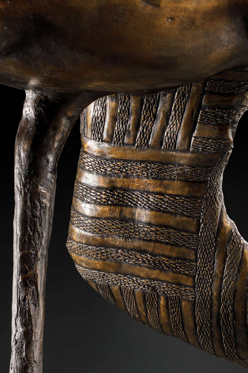 A detail image featuring designs on the inside of the bronze brolga sculpture's wing.
