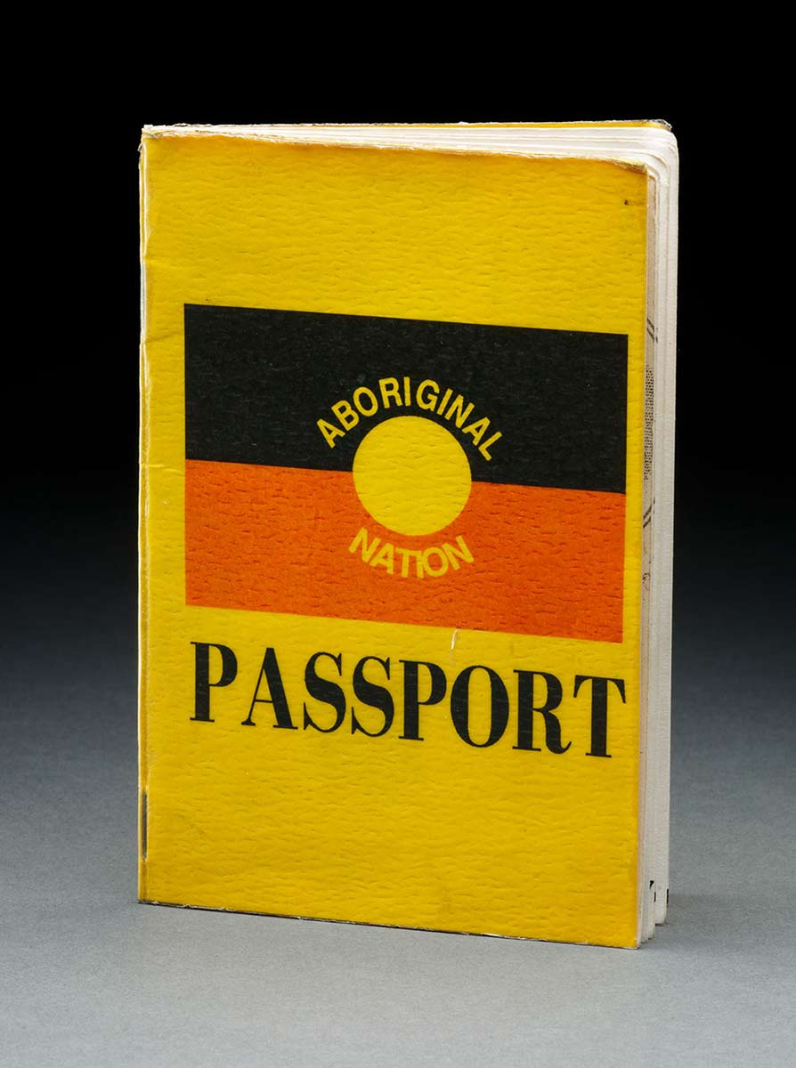 A yellow passport with a cover showing the Aboriginal flag with the text 'ABORIGINAL NATION PASSPORT'. - click to view larger image