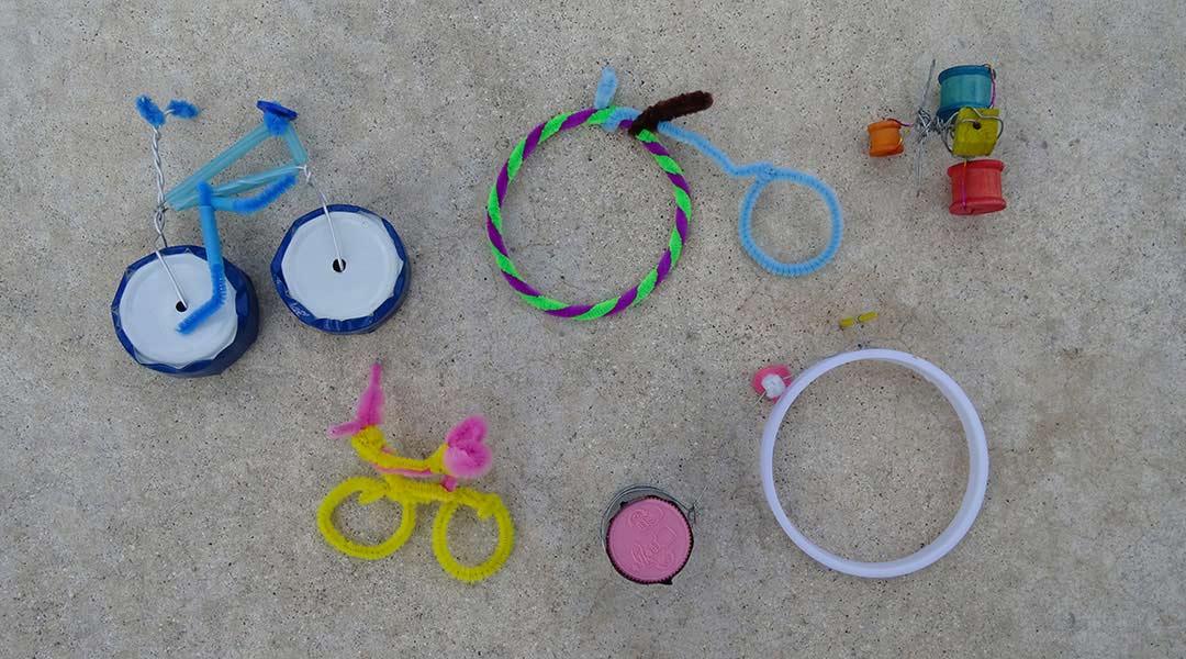 An assortment of mini bike sculptures made from craft materials.