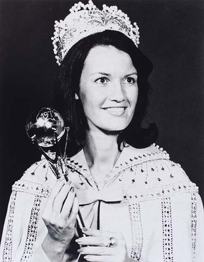 Miss Australia 1975, Kerry Doyle holding the sceptre wearing the crown and a long beaded cape - click to view larger image