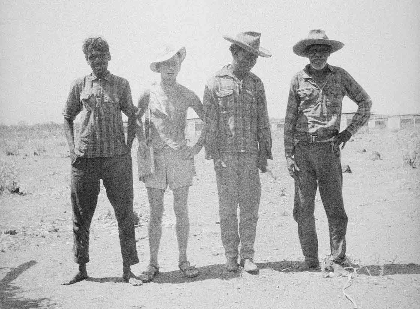 A black and white photo of Freddy Jangala Patrick (left), Mervyn Meggitt and two unidentified men