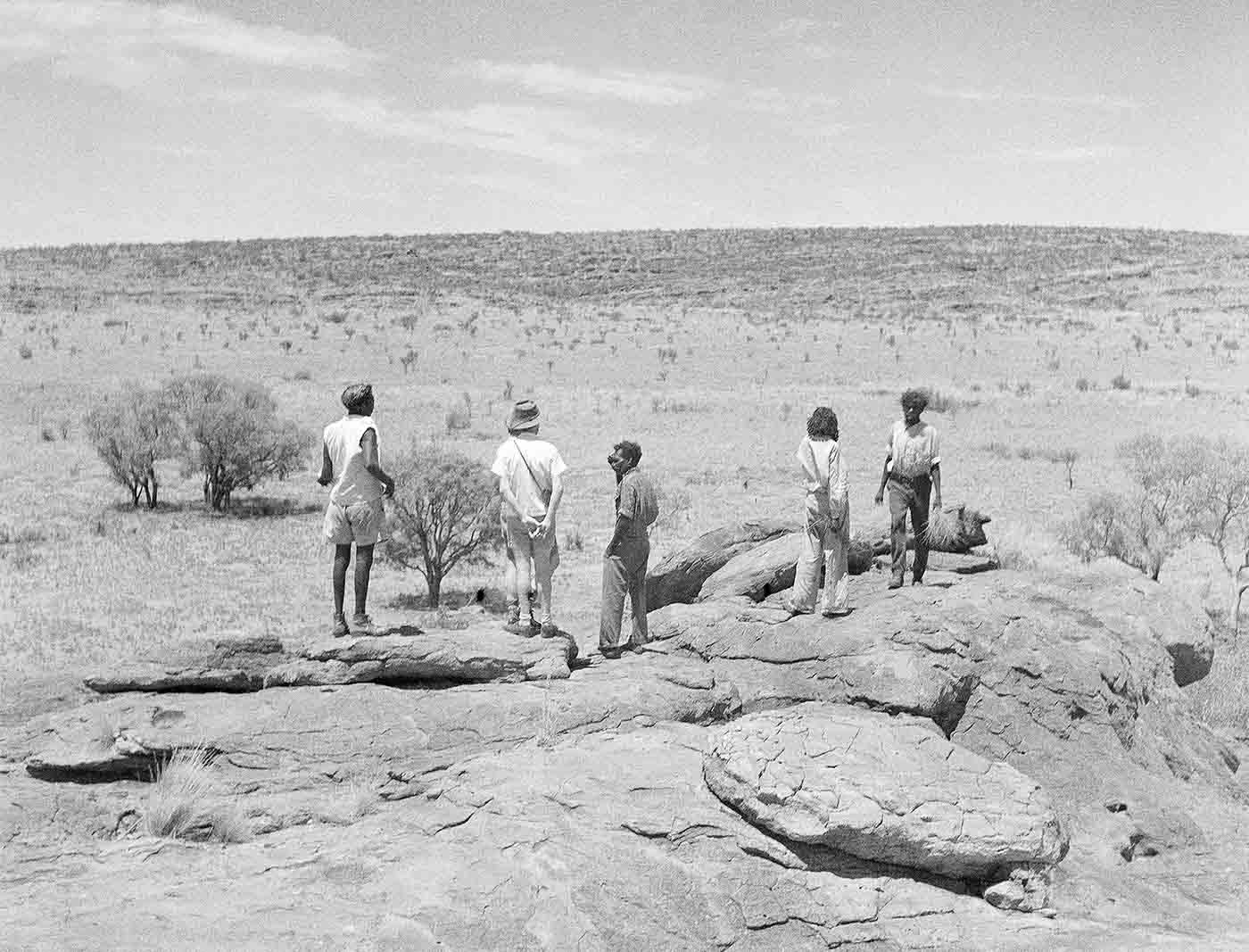 A black and white photo of Mervyn Meggitt with unidentified men at Ngama.