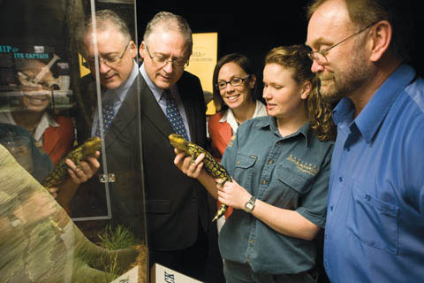 Renee Osterloh shows a blue-tongue lizard to Alan Draeger, Katy McDonald and Michael Pickering.