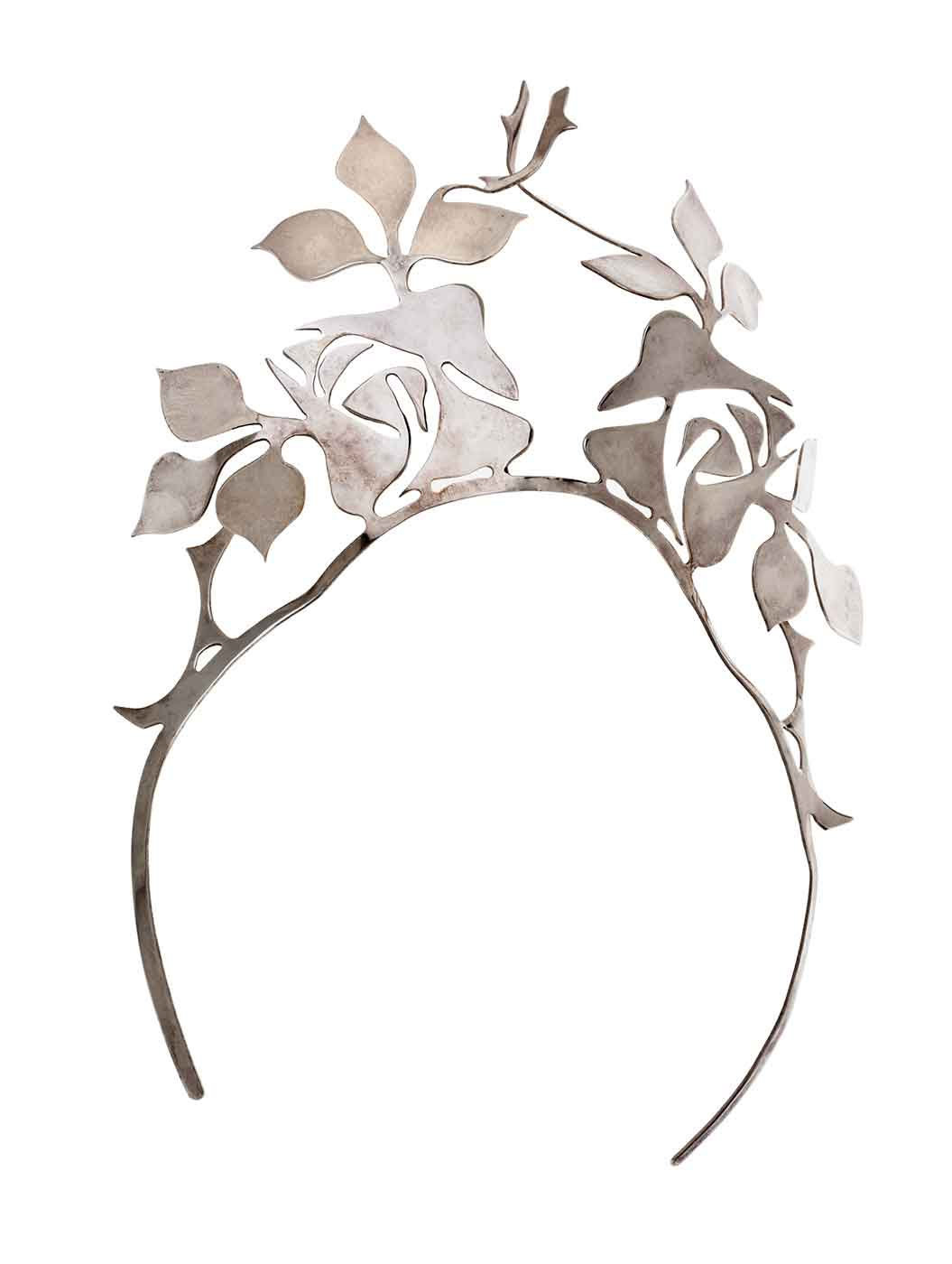Silver tiara featuring ornate design of leaves.