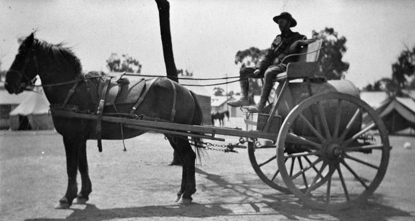 Soldier driving a horse-drawn carriage