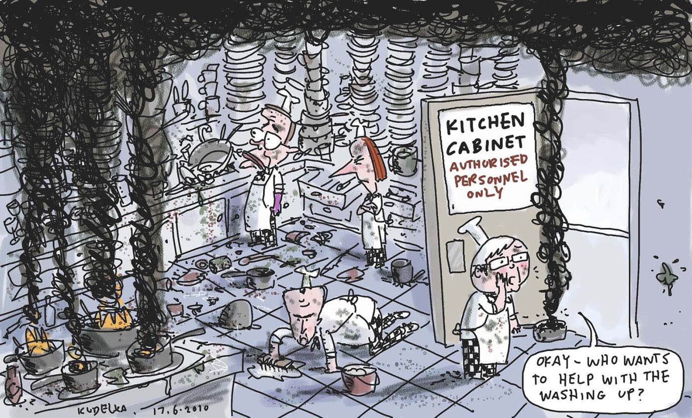A colour cartoon depicting Kevin Rudd, Wayne Swan, Lindsay Tanner and Julia Gillard in a kitchen. On the kitchen benches are enormous piles of dirty dishes. On a stove are several pots, all with their contents burning. Thick black smoke rises up from the pots and hangs in the air. On the door of the kitchen is a sign that says 'Kitchen Cabinet. Authorised Personnel Only'. Kevin Rudd stands at the open door, holding a pot with smoking contents. He calls the following through the door: 'Okay - who wants to help with the washing up?'  - click to view larger image