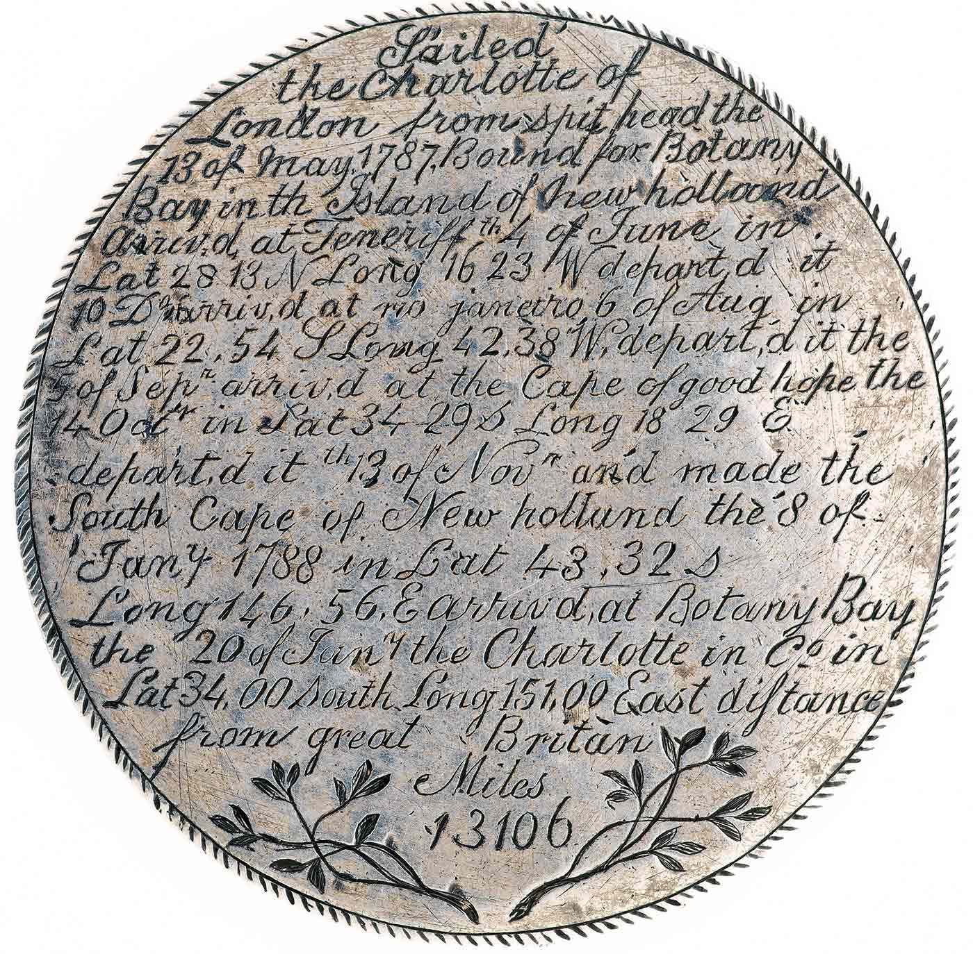 Back view of a silver medal with inscription of text and branches. - click to view larger image
