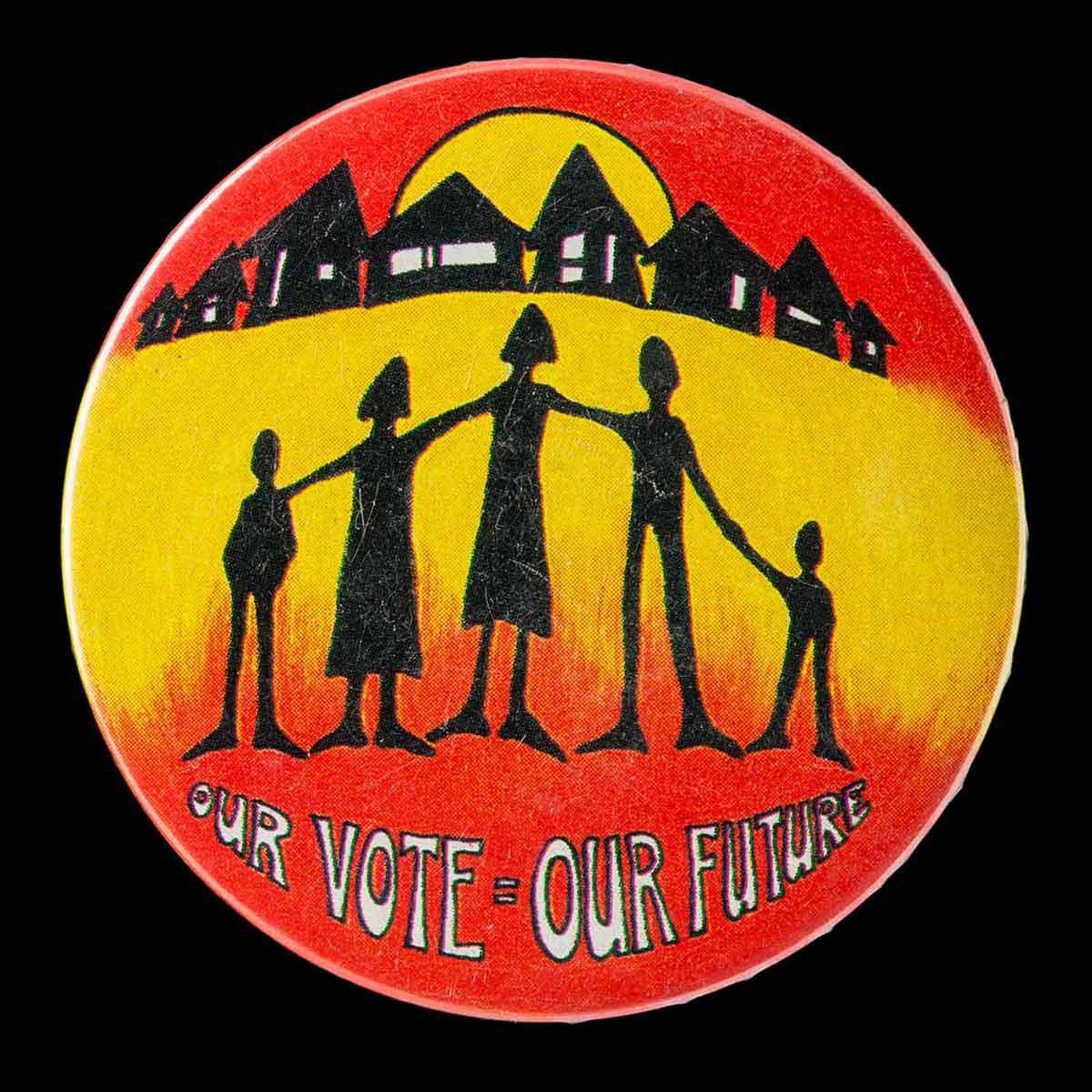 Circular badge with an illustration of silhouettes of human forms with a row of houses in the background and the text: OUR VOTE=OUR FUTURE. - click to view larger image