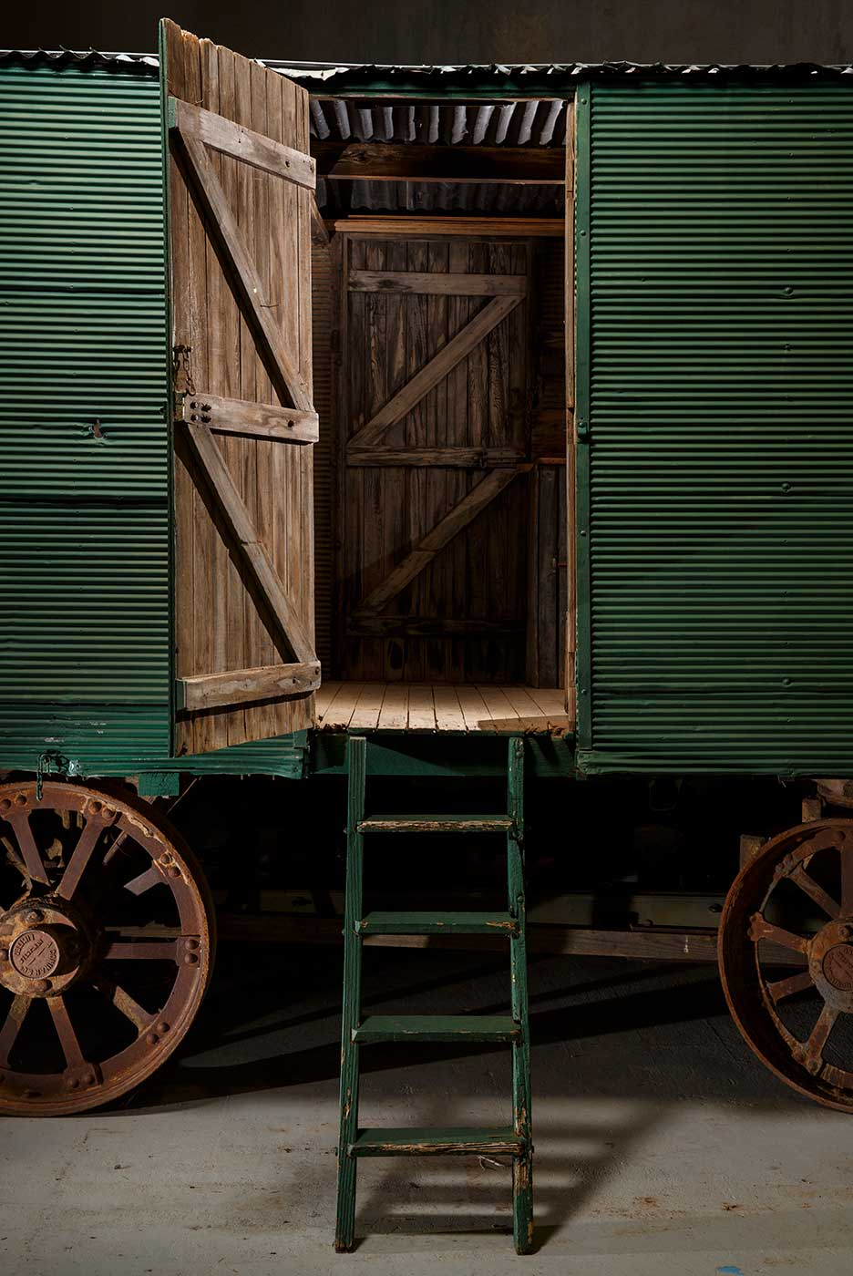 A cook's galley in the form of a metal-clad, timber and iron-framed box raised on wagon wheels. This is a view of the side doors. - click to view larger image