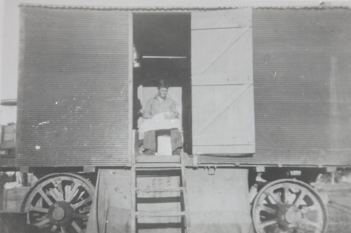 A young mans sits inside a carriage. - click to view larger image