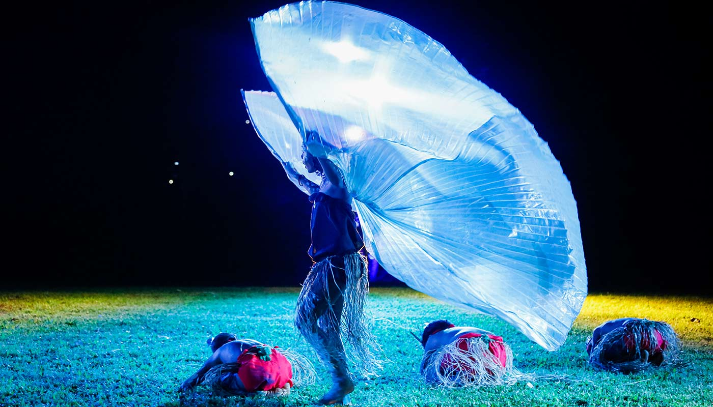 A small dance group performing at night at a Cooktown Discovery Festival.
