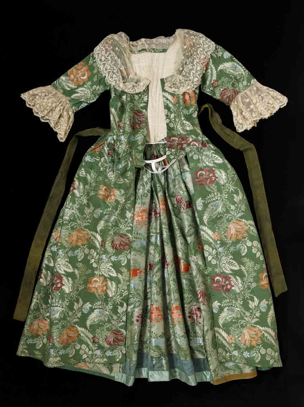 Green and floral brocade open-front gown with lace trim. - click to view larger image