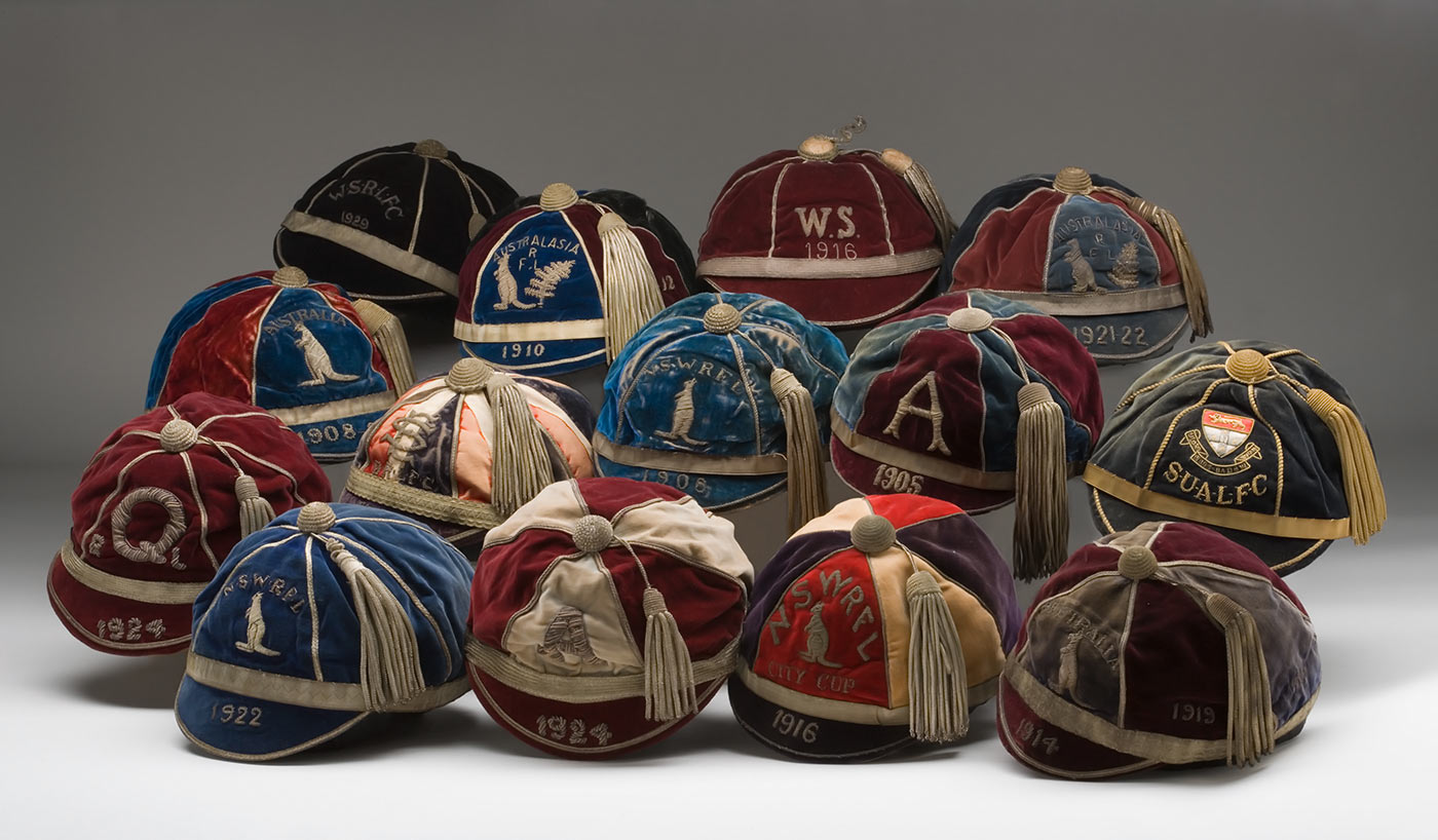 An assortment of early rugby league caps, in various team colours.