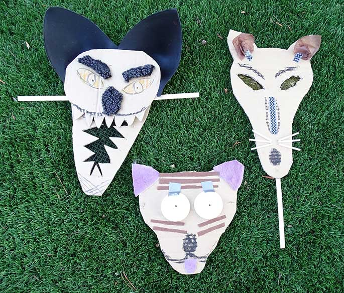 Three thylacine masks.