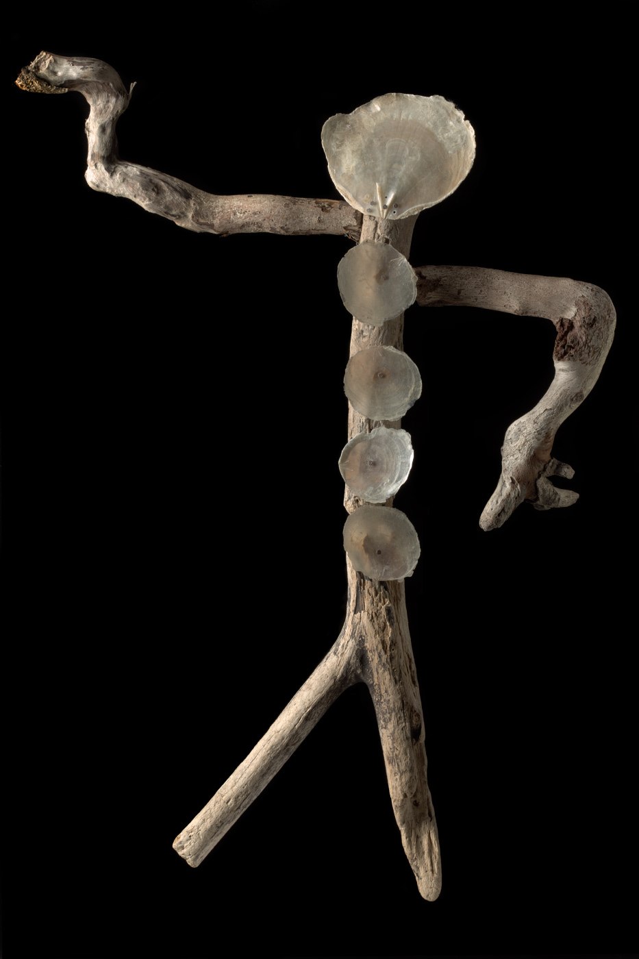 A figurative artwork made from driftwood, pearl shell and copper wire. - click to view larger image