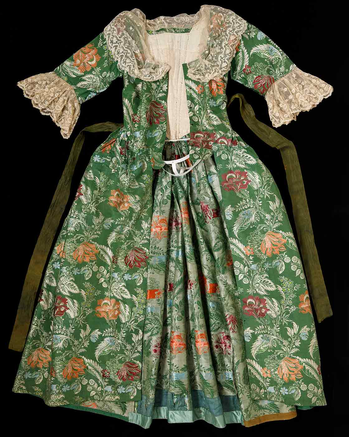 Green and floral brocade open-front gown with lace trim.
