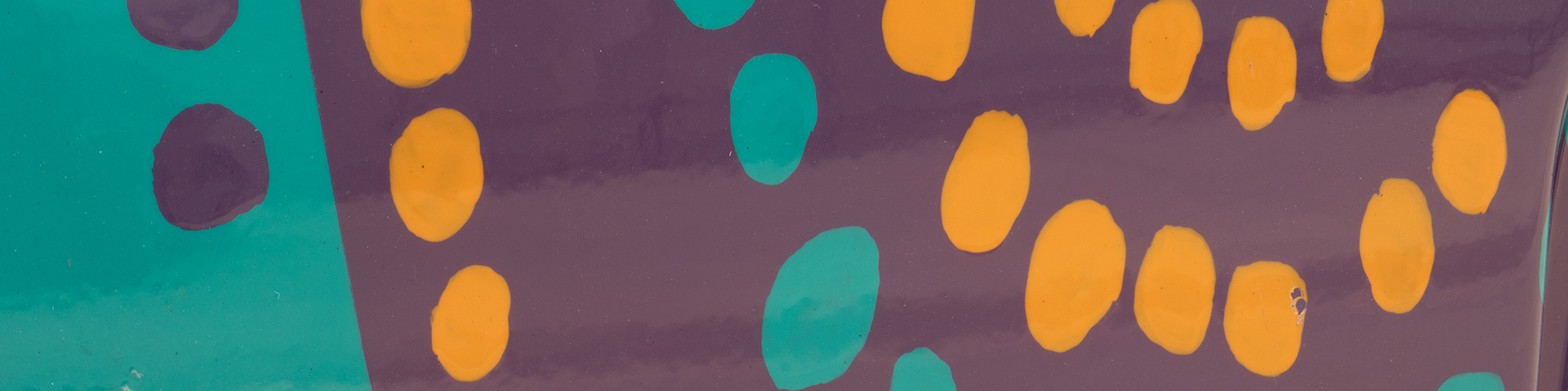 Cropped image of Wunala Dreaming design by John Moriarty, from a Twingo car, featuring teal, orange and purple dots.