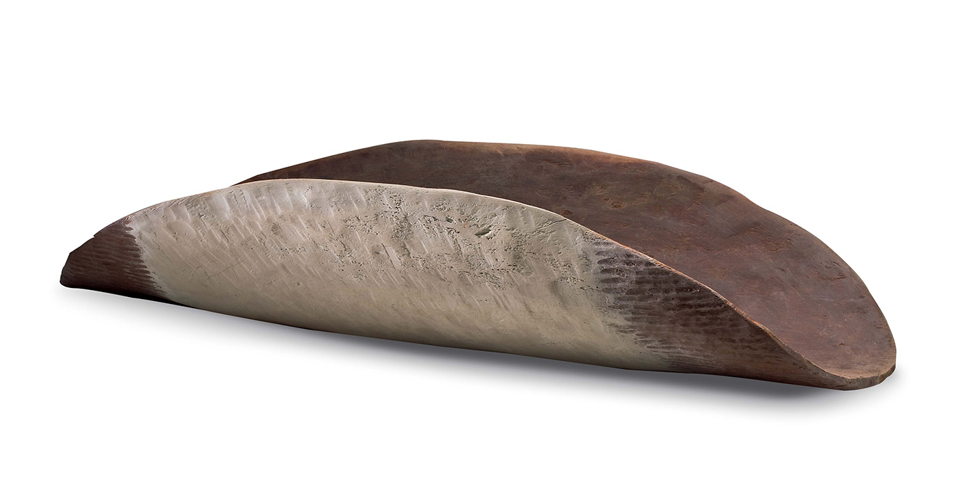A large red-brown wooden concave oval container with a pale beige painted central section on the outer surface. The outer surface ends are vertically grooved whereas the painted area is smoothed. The inner surface is smoothed with a transparent wash like effect on it. There is a hairline crack down the centre of the container as well as structural cracks in the wood. - click to view larger image