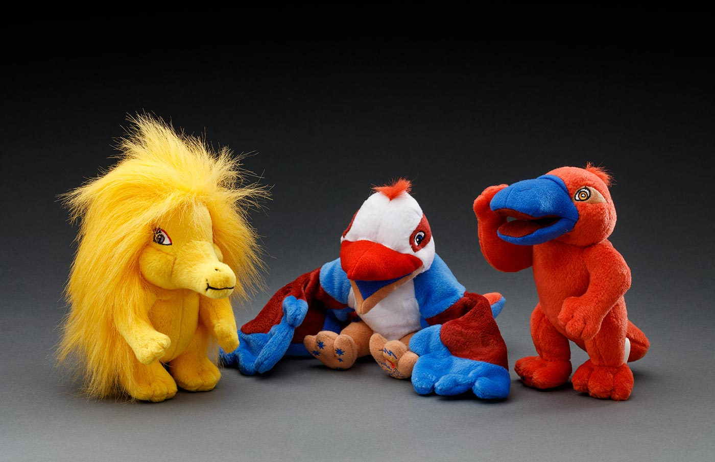 Three colourful stuffed toy mascots including an echidna, kookaburra and a platypus. - click to view larger image