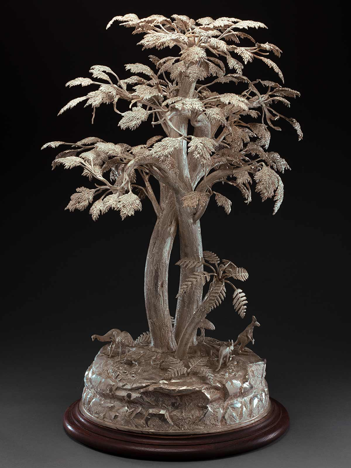 Silver tree with small silver kangaroos and emus on a round base. - click to view larger image