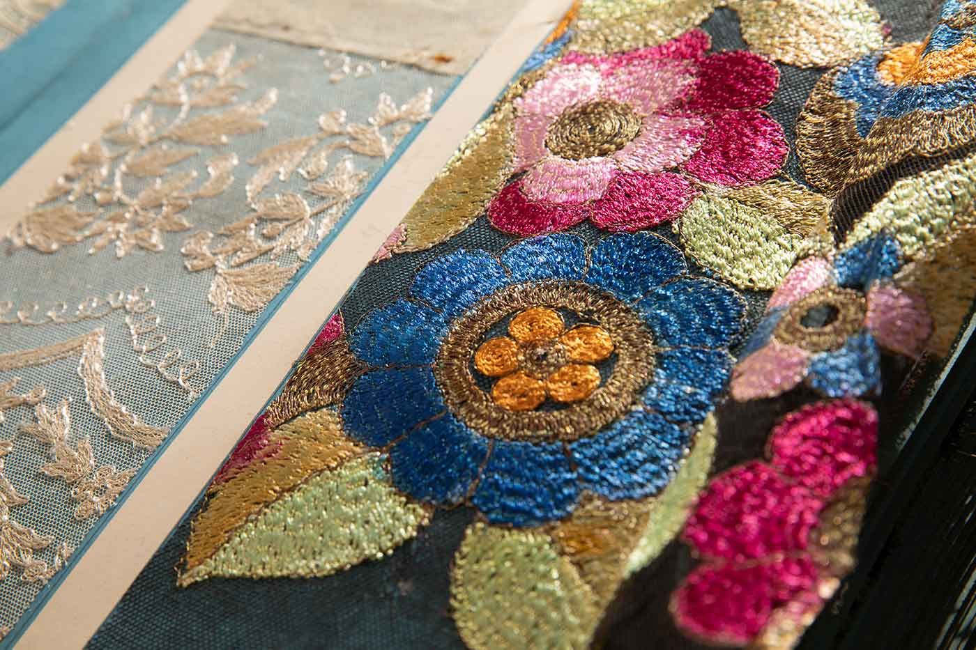 Colour photo of detail of lace samples.