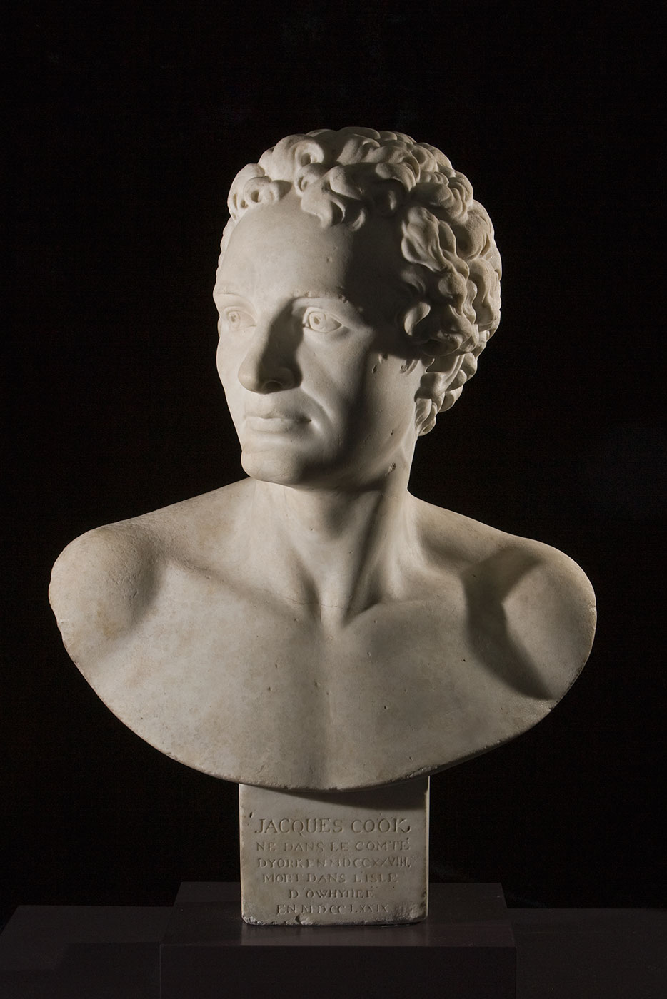 Marble bust of Captain James Cook with an inscription in French on the base.