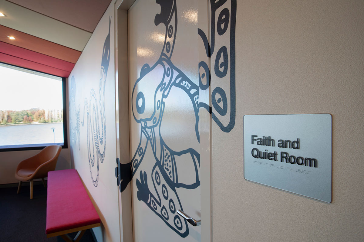 Entrance to a room with a sign that reads 'Faith and Quiet Room'. - click to view larger image