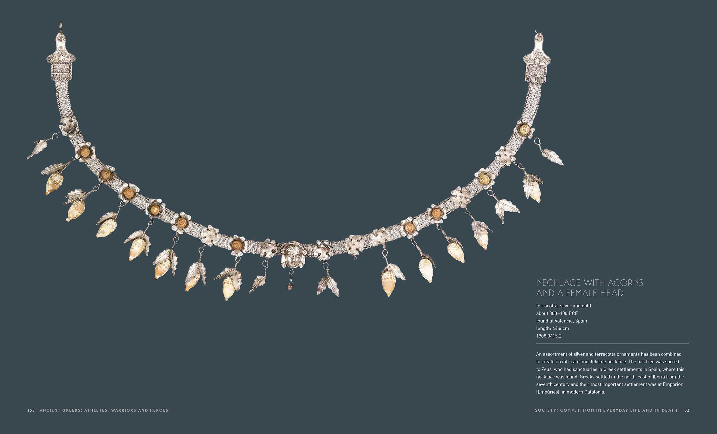 Sample page of a catalogue featuring an ornate necklace made of precious metals and text. - click to view larger image