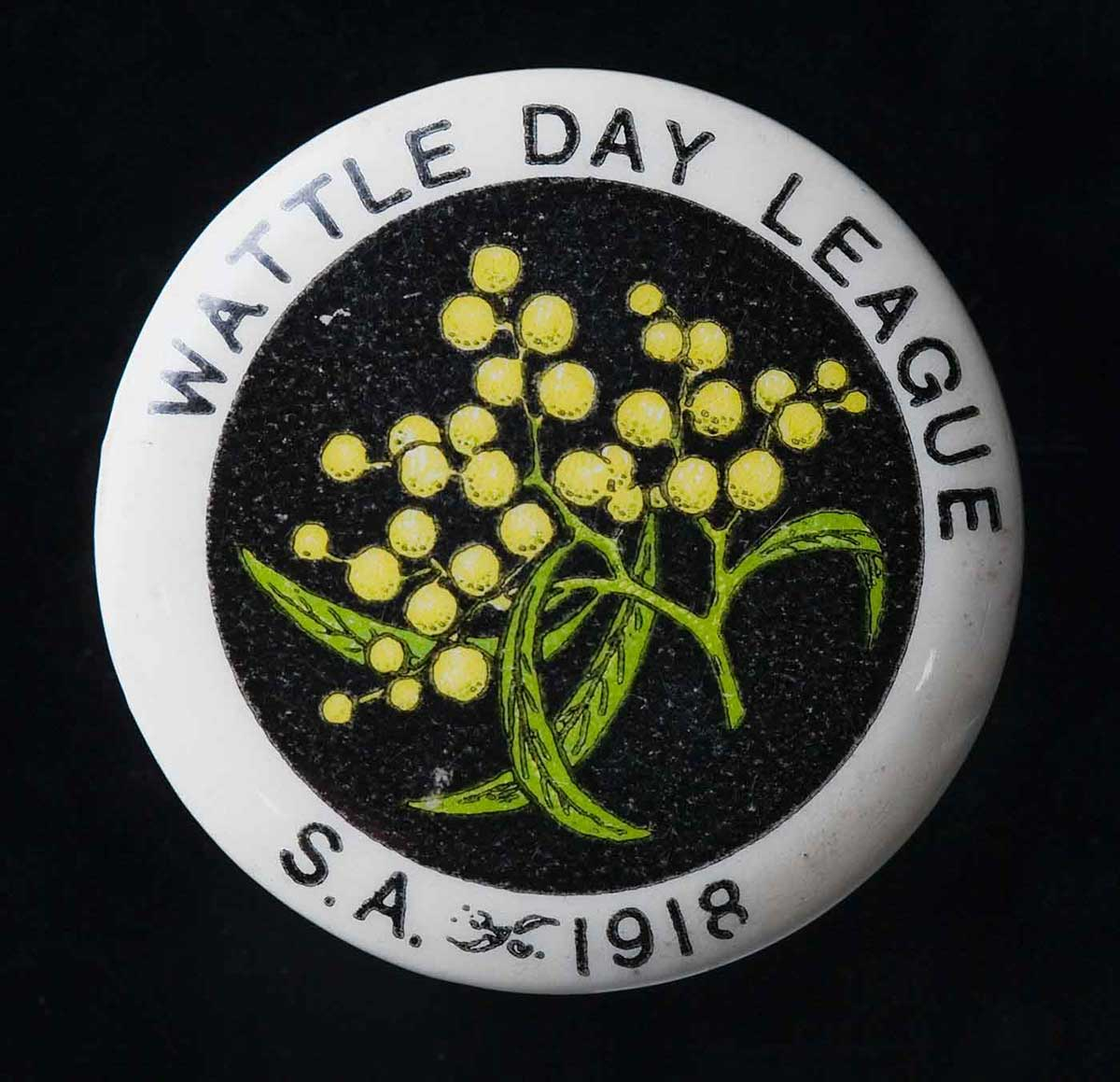 Circular badge with an image of wattle in the centre. The words 'WATTLE DAY LEAGUE. S.A. 1918' appear around the edge. - click to view larger image