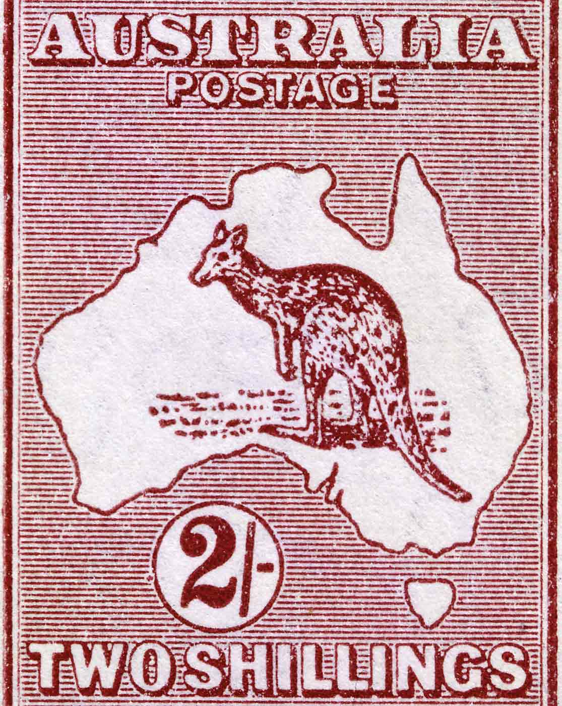 Central portion of a postage stamp with perforated sides. 'Australia Postage' is written across the top and 'Two Shillings' across the bottom. The stamp is rust and white in colour and includes a central illustration of a kangaroo in a map of Australia. - click to view larger image