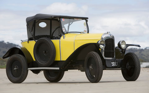 Yellow Citroen car with black hood
