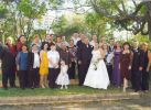 Wedding photo of a bride and groom with family members from Joyce Yuke's family album