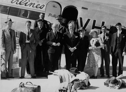 Arrival at Parafield Airport, Adelaide, from Melbourne, March 1948. Left to right: Dave Johnson, Herbert Deignan, Raymond Specht, Frederick McCarthy (behind), Charles P Mountford, Keith Cordon (behind), Frank Setzler, Peter Bassett-Smith, Bessie Mountford, Howell Walker and Robert Miller.