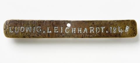 Front view of the Leichhardt nameplate which is a piece of brass 15 cm x 2 cm marked LUDWIG. LEICHHARDT. 1848