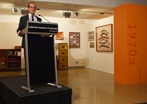 Director Andrew Sayers welcomes guests. Behind him is the 1970s era 'office.
