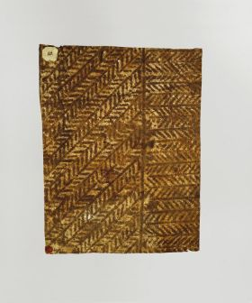 Barkcloth featuring brown herring-bone pattern in which each stripe is separated from the other by a line.